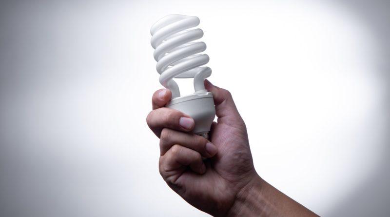 energy saving lightbulb in hand
