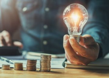 Man with lightbulb and money