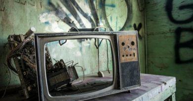 broken disasembled vintave TV on table