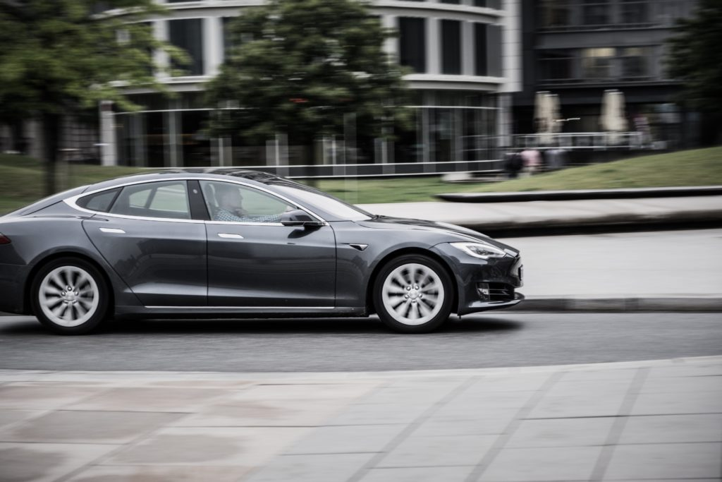 Black Tesla speeding in city