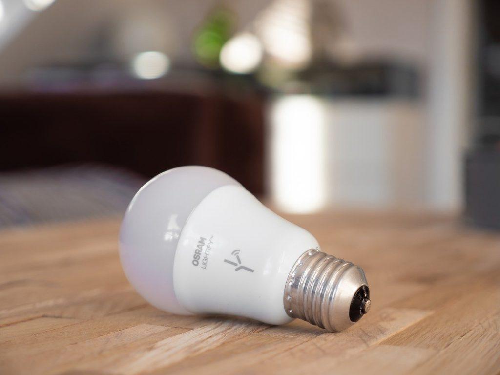 Energy saving lightbulb on wooden table
