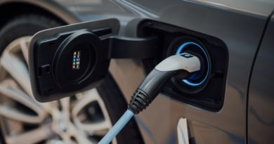 an electric car's charging port with charger plugged in