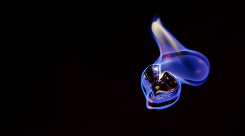 blue hydrogen flame on black background